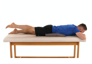 man laying on chiropractic massage table