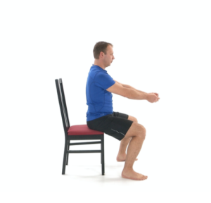man using chair for physical therapy sit stand exercise - sitting