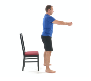 man using chair for physical therapy sit stand exercise - standing