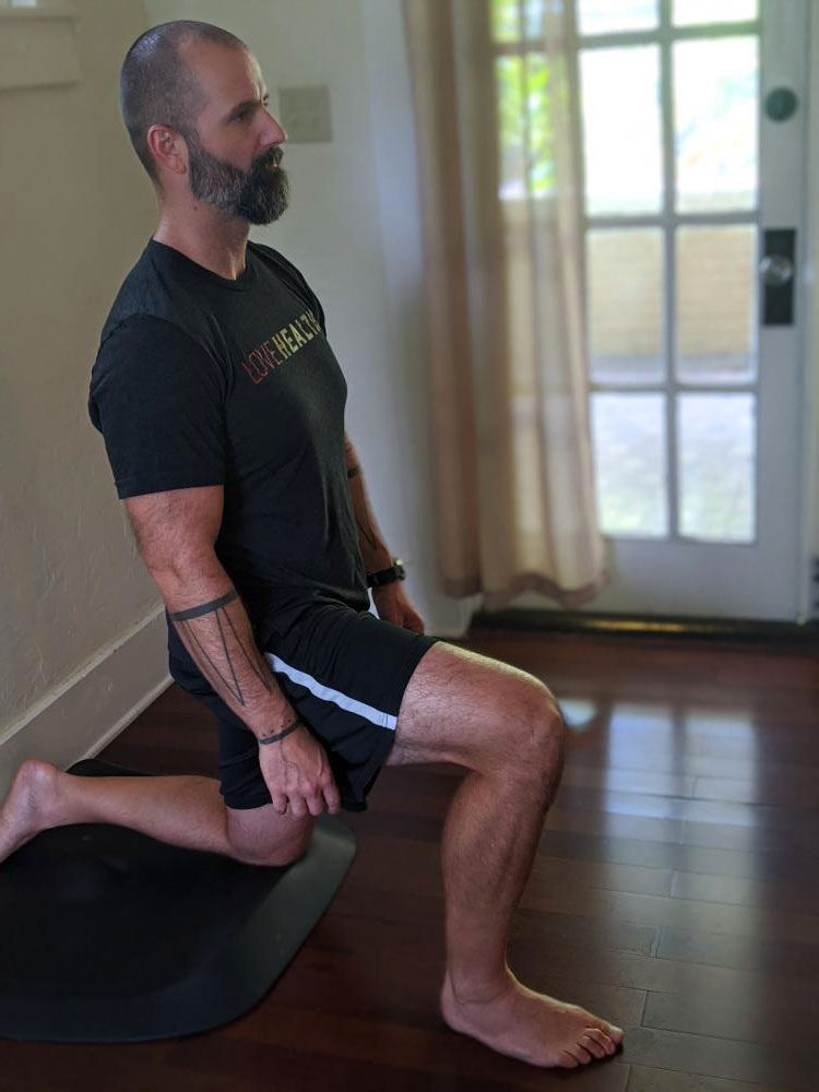 man doing lower back stretch for physical therapy