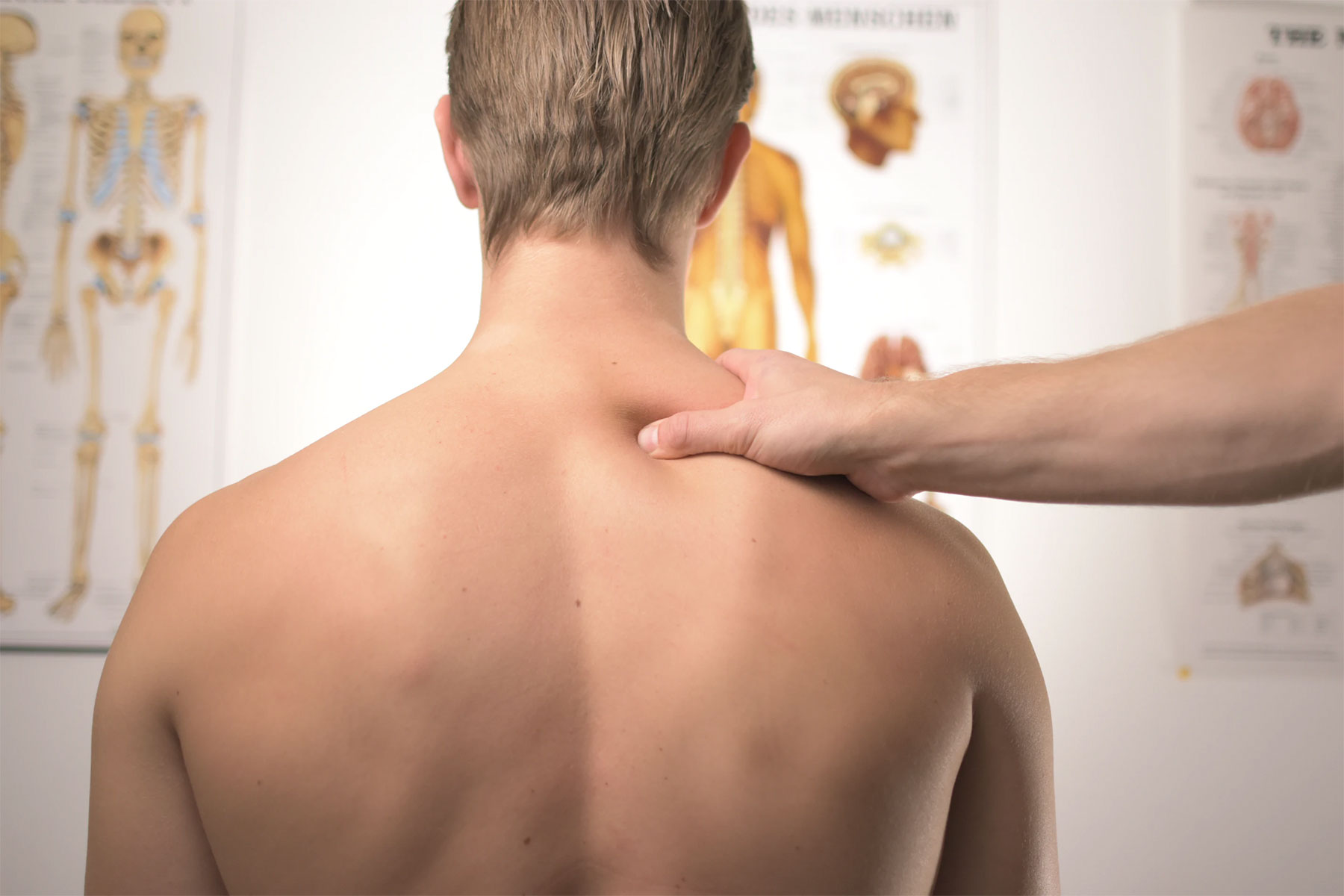 man receiving physical therapy massage on his back