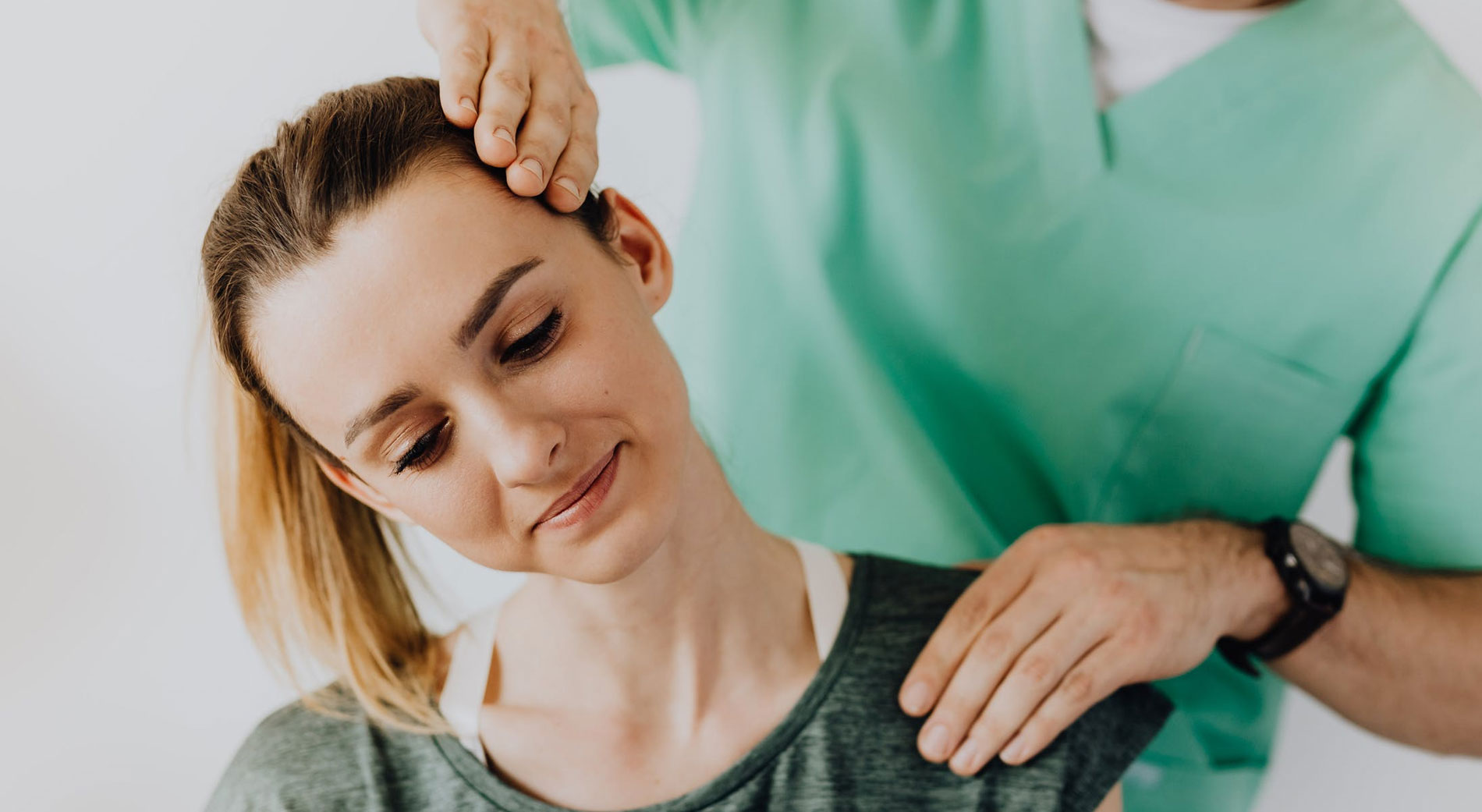 woman receiving treatment for shoulder injury